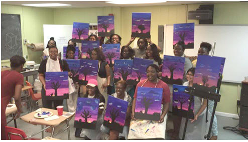 CALA-Bash workshop participants holding their artwork