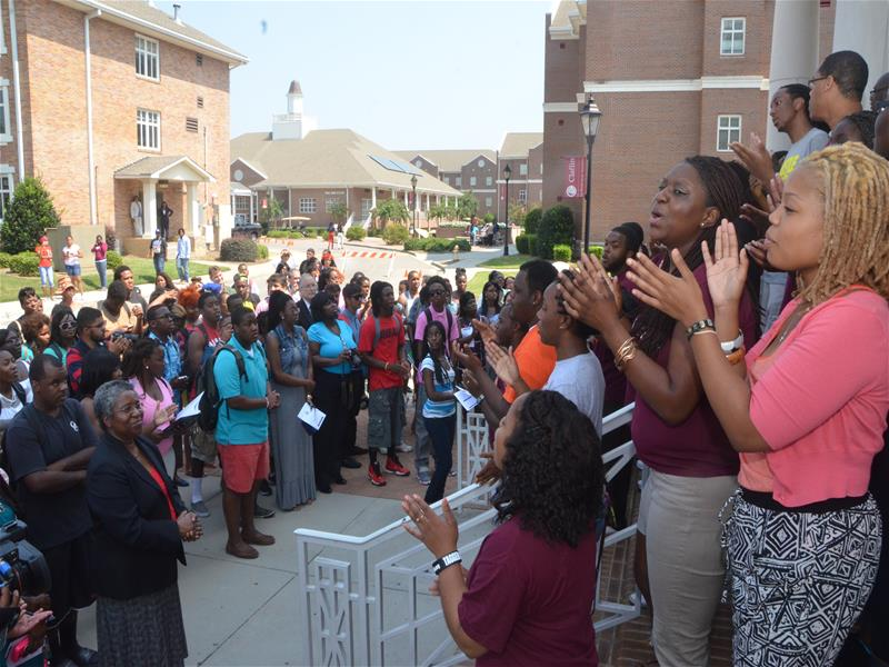 Claflin Students and Staff Singing during commemoration