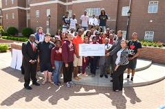 Students Posing with Donation for Philanthropy Day at Claflin